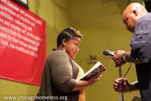 Wayne Richard prepares the mic for poet Clorinda Johnson in 2012 (Photos by Jeff Foy)