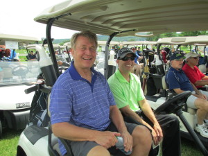 CCH Executive Director Ed Shurna and Board Member Christopher Ward are ready to roll out to their assigned hole and begin the 2014 Golf Outing.