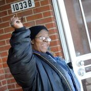 Juanita Patton celebrates as she's about to see her new apartment in Ford Heights (Photos by Stephanie Dowell for Respond Now)
