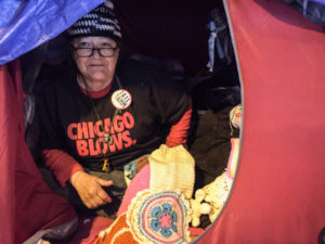 Linda, who crochets hats and other items from her tent beneath the Wilson Avenue viaduct on Lake Shore Drive, is skeptical about the cityÕs promise to find her housing. ÒI aint gonna hold my breath,Ó she said. | Mark Brown/Sun-Times