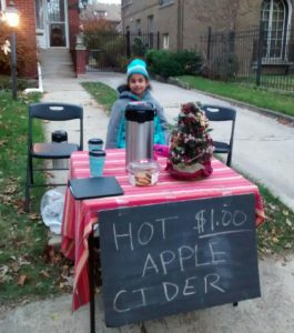 Peninah at her hot cider stand