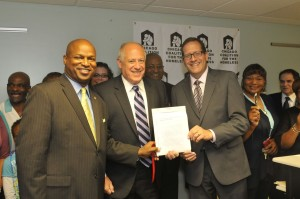 Gov. Quinn with State Rep. Welch (left) and State Sen. Silverstein (right) after signing the bill.