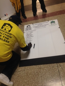 By the end of the morning, 132 ex-offenders had signed their intent to apply to the Chicago Housing Authority (Photo by Hannah Willage)