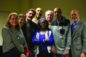 Clients and pro bono partners with Law Project Director Patricia Nix-Hodes (left)