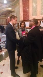 Chicago Coalition for the Homeless leader Charles Austin talks with Rockford Republican Rep. Joe Sosnowski.