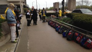 Homeless youth set up 25 backpacks outside a luxury condo building where Gov. Bruce Rauner has one of his nine homes, to compare the only storage the homeless have to what the governor has. (Credit: Mike Krauser)